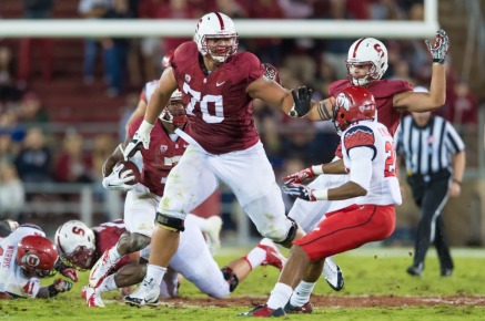 Andrus Peat charges at a hopeless Utah defender Photo via: www.stanforddaily.com