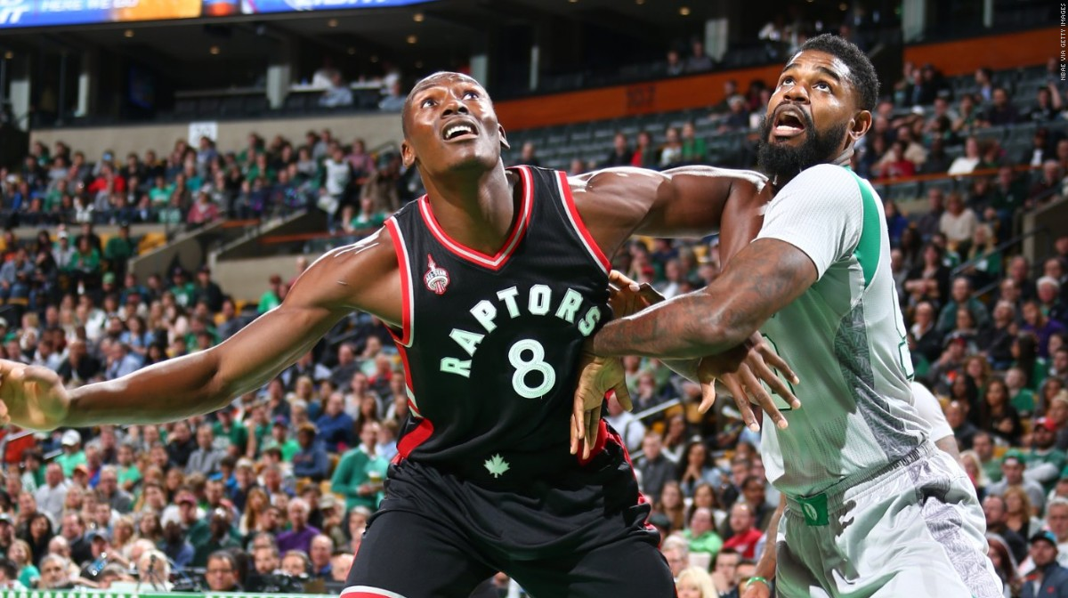 BOSTON, MA - OCTOBER 30: Bismack Biyombo #8 of the Toronto Raptors boxes out against Amir Johnson #90 of the Boston Celtics during a game on October 30, 2015 at TD Garden in Boston, Massachusetts. NOTE TO USER: User expressly acknowledges and agrees that, by downloading and or using this photograph, User is consenting to the terms and conditions of the Getty Images License Agreement. Mandatory Copyright Notice: Copyright 2015 NBAE (Photo by Nathaniel S. Butler/NBAE via Getty Images)